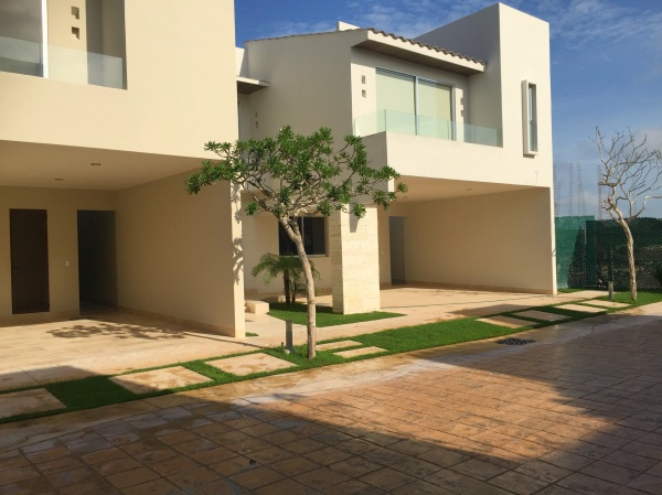 House for sale in exclusive gated community at Temozon Norte. Facade