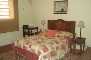 Bedroom 1. Furnished beach house for rent at Chicxulub in second row.